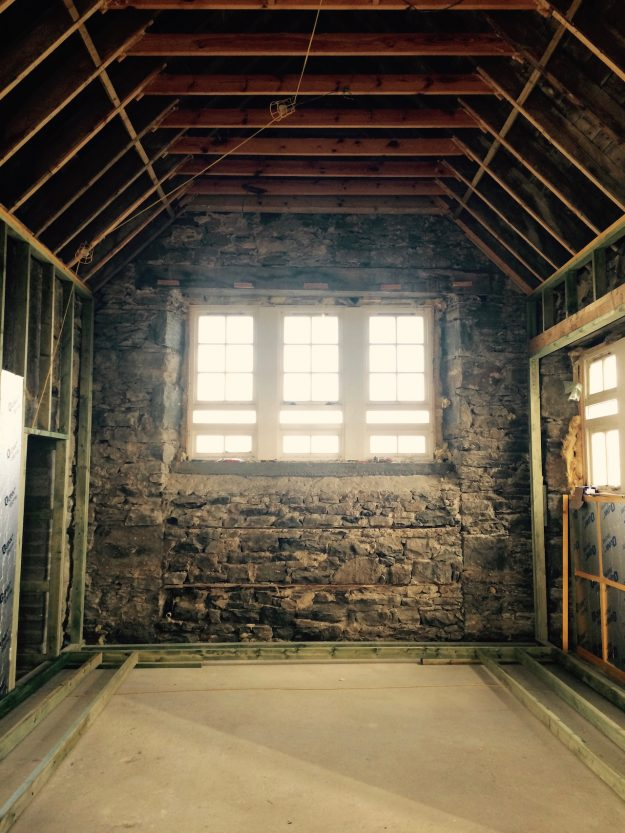 Tigharry Schoolhouse About interior stone wall large window